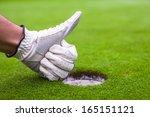 men's hand in a glove golf... | Shutterstock . vector #165151121