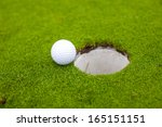 golf ball go to the hole | Shutterstock . vector #165151151