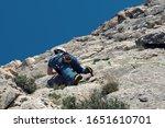 rock climber in spanish... | Shutterstock . vector #1651610701