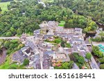 Small photo of An aerial view of the village of Cong, straddling the County Galway and County Mayo borders in Ireland.