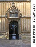 """translation is """"Academicians of Oxford, Thomas Bodley has built this library for you and for the Republic of the Learned. May the gift turn out well."""" statue of William Herbert 3rd Earl of Pembroke"""