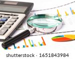 Small photo of Magnifying glass on charts graphs paper. Financial development, Banking Account, Statistics, Investment Analytic research data economy, Stock exchange trading, Business office company meeting concept.