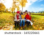 group of smiling happy kids... | Shutterstock . vector #165220661