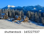Traditional mountain houses in Glodowka in winter landscape, High Tatra Mountains, Poland - stock photo