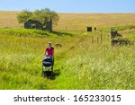 walk with a stroller defunct village - stock photo