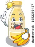 a clever cashew milk cartoon... | Shutterstock .eps vector #1652399437