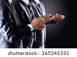 male hands clapping on black ... | Shutterstock . vector #165241331