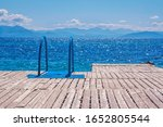 View Of Wooden Pier With Blue...