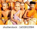 Small photo of Varanasi, Uttar Pradesh - April 23 2019 : Young boys who have devoted their life to Sankaracharya are the ardent devotees of Shiva seen in the ghats of varanasi or benaras eating their breakfast.