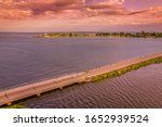 Small photo of New England summertime sunset on the Connecticut River and Long Island Sound with Lynde Lighthouse and Fenwick in the background