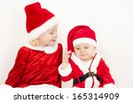 Two Little Girls As Santa...