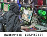 Small photo of KYIV, UKRAINE - APRIL , 2019: People playing computer games at Republic of Gamers booth, a brand used by Asus since 2006, encompassing a range of PC gaming. CEE 2019, electronics trade show.