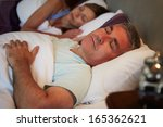 middle aged couple asleep in... | Shutterstock . vector #165362621