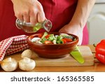 hand man chef cooking vegetable ... | Shutterstock . vector #165365585