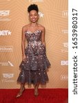 Small photo of LOS ANGELES - FEB 23: Logan Browning arrives for the 2020 American Black Film Festival Honors on February 23, 2020 in Beverly Hills, CA