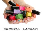 woman hands with nail polishes... | Shutterstock . vector #165406634