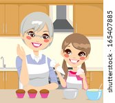 grandmother teaching cooking to ... | Shutterstock .eps vector #165407885