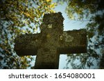 Stone Cross Crucifix At An Old...