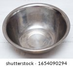 Stainless Steel Bowl On Wooden...