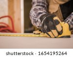 Sheetrock Drywall Measuring by Construction Worker. Closeup Industrial Photo.  - stock photo