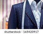 suits on shop mannequins | Shutterstock . vector #165420917
