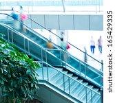 people rush on escalator motion ... | Shutterstock . vector #165429335