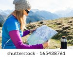 Young Woman Backpacker Hiker...