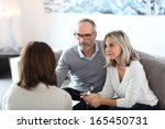 senior couple meeting financial ... | Shutterstock . vector #165450731