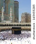 Small photo of MECCA - JUNE 30 : A crowd of pilgrims circumabulate (tawaf) Kaaba on June 30, 2011 in Mecca, Saudi Arabia. Pilgrims circumambulate the Kaaba seven times in counterclockwise direction.