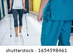 Woman Patient Using Crutches...