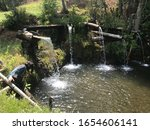 Small photo of Water fluent on the hill