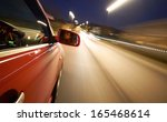 a man driving a car at night... | Shutterstock . vector #165468614