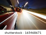 a man driving a car at night on ... | Shutterstock . vector #165468671
