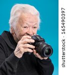 Old Woman With Photo Camera On...