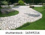 A Stone Walkway Through An...