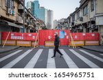 "Small photo of Shanghai, China - Feb. 23, 2020: the community block the main street leading to residential area, during Wuhan coronavirus outbreak. The signs said ""Road Blocked""""Road Blocked"" ""fight the Coronavirus"""