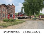 Small photo of Diesel loco unter a tree (Wittenberge)