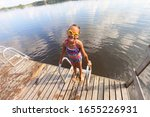 smiling girl on the pier after... | Shutterstock . vector #1655226931