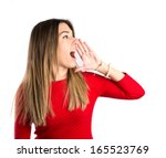 young girl shouting over... | Shutterstock . vector #165523769
