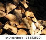 woodpile of chestnut and beech for stoves - stock photo