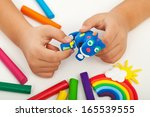 child playing with colorful...   Shutterstock . vector #165539555