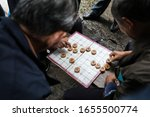 People Playing A Traditional...