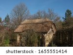 Thatched Roof Summerhouse In A...
