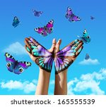 hand and butterfly hand... | Shutterstock . vector #165555539