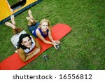 couple lying down near tent | Shutterstock . vector #16556812