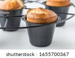 A Close Up Of A Pan Of Popovers ...