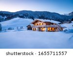 Wooden chalet in the alps on a...