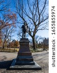 Small photo of Manhattan, New York , NYC, United States - December 7, 2019. Bronze sculpture of William Shakespeare by John Quincy Adams Ward in Central Park, Manhattan, New York City.