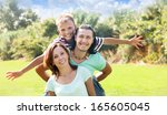 happy couple with teenage son ... | Shutterstock . vector #165605045