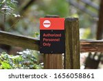 Small photo of Authorized Personnel Only Sign on Fence